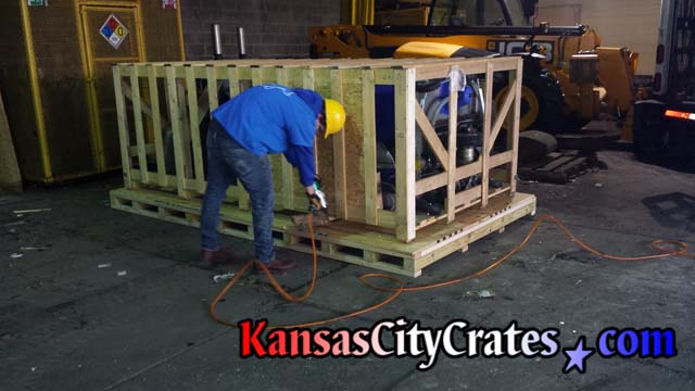 Industrial pallet under large crate fastened with ringshank nailer