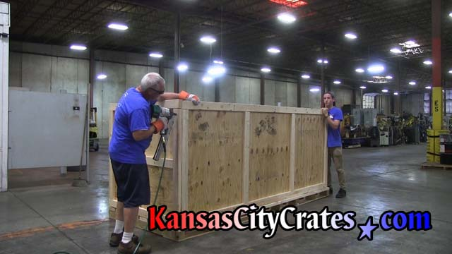 Crate builders assemble knock down style of crate at automotive parts manufacture