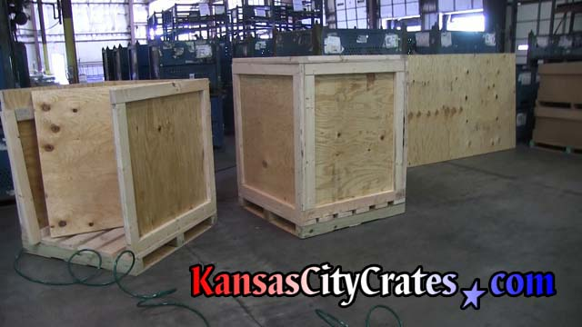 Two industrial crates on pallet bases to load machinery parts for shipping