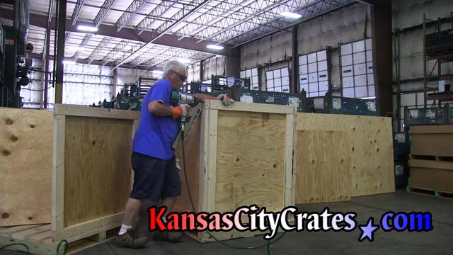 Crate builder ringshank nails sidewall of industrial crate to end panel