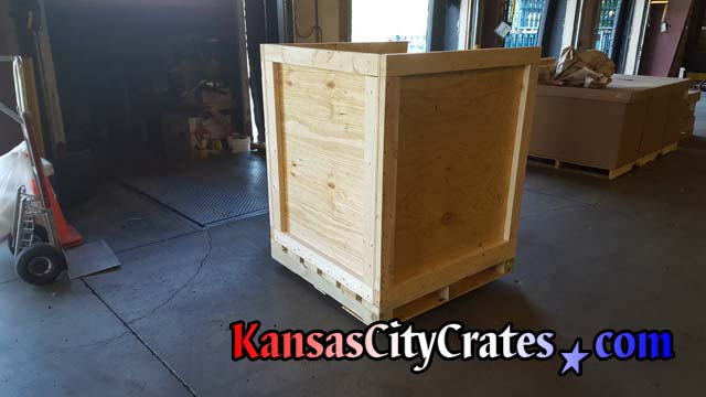 Assembled side view of industrial heavy duty vault crate with forklift base