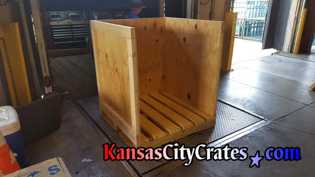 Heavy Duty Industrial crate made of 2 by 4 and five eights plywood with 4 by 4 pallet base
