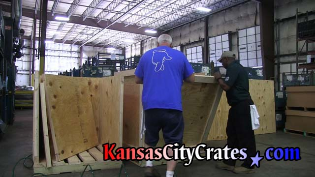 Customer inspects arrival of heavy duty industrial vault crates