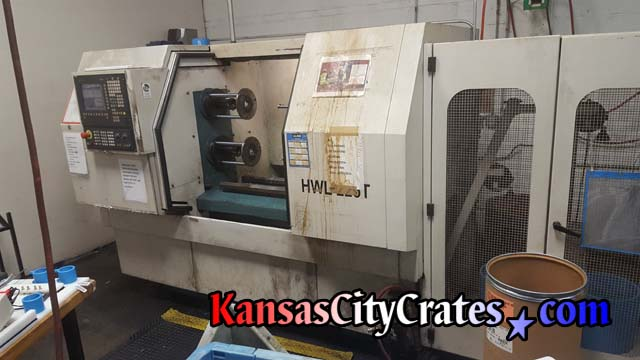 Industrial lathe at aerospace manufactoring facility is prepared for HD Industrial Crating