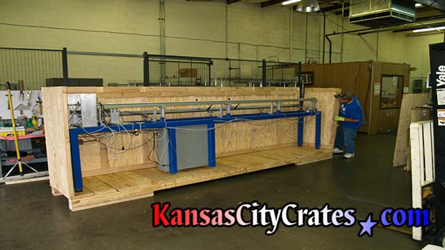 Crate builder assembles large industrial crate with pneumatic ringshank nailer