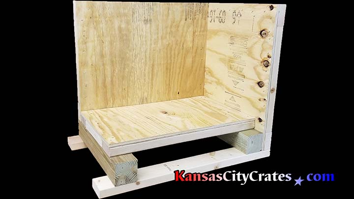 Side and end panels removed to show design strengths of heavy duty vault crate for international shipping of sensitive instruments.