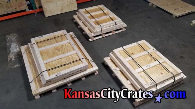 Three knock down style crates steel banded for delivery