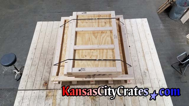 heavy duty vault crate knock down style steel strapped by crate builders on shop workbench