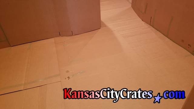 Heavy cardboard protects hardwood floor in condo on the Country Club Plaza