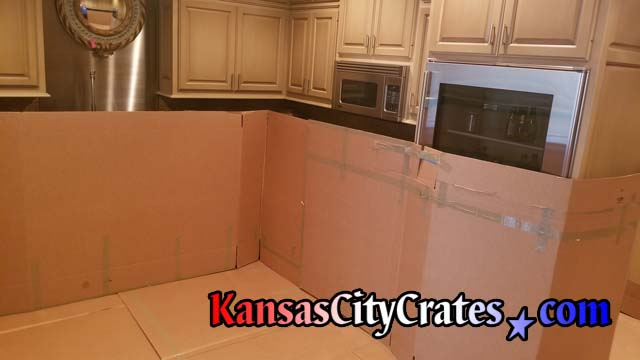 large cardboard protects the interior walls of condo during crate service