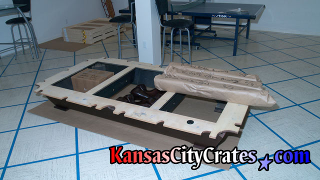 After billiard table is disassembled, all parts are left on cardboard to protect the floor.