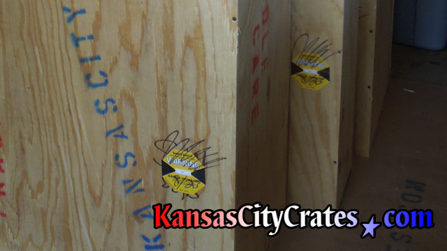 Job site photo of impact indicators affixed to crates that monitor handling while in the chain of custody during transit.