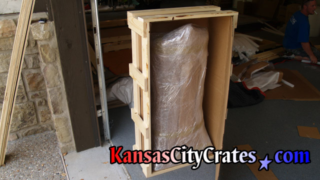 Side view of cardboard sheathed crate popular with movers at home in Edwardsville KS  66111