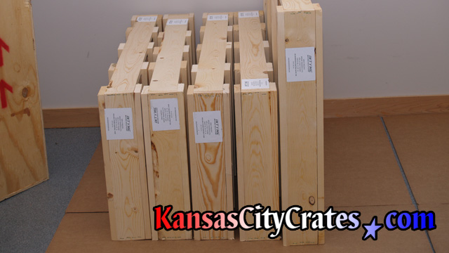 Domestic slat crates on carboard with shipping labels at home in Gardner KS  66030