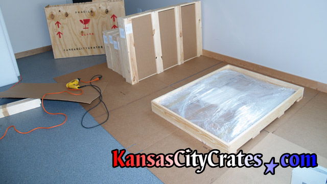 Open domestic slat crate with wrapped item inside before labeling.
