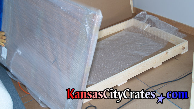 Domestic slat crate sitting on flooring protection ready for portrait at home in Gladstone MO  64118