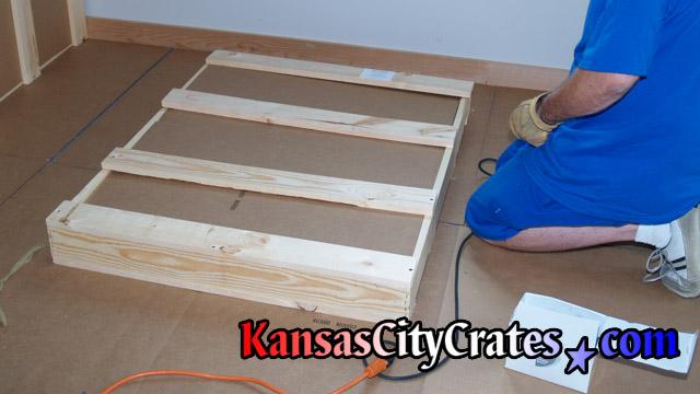 Screwing closed domestic slate crate for portrait at home in Kansas City MO