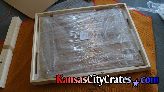 Crate on furniture blanket with picture packed inside at home in St Joseph MO  64506