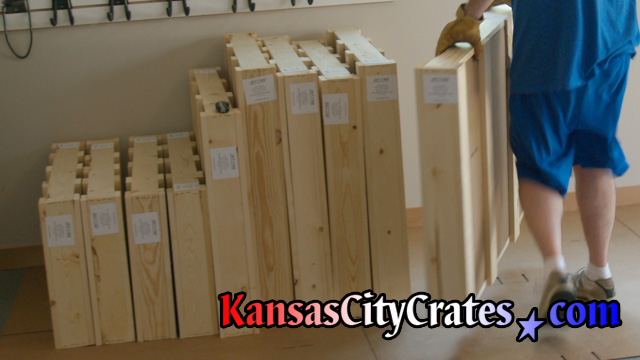 Domestic slat crates staged on cardboard ready for loading at home in Overland Park KS  66223