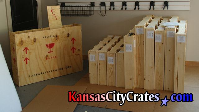 Crates are marked and labeled for transport sitting on cardboard at home in Prairie Village KS  66208