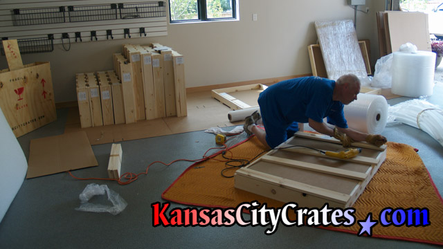 Work area photo of crates being packed at home in Kansas City MO