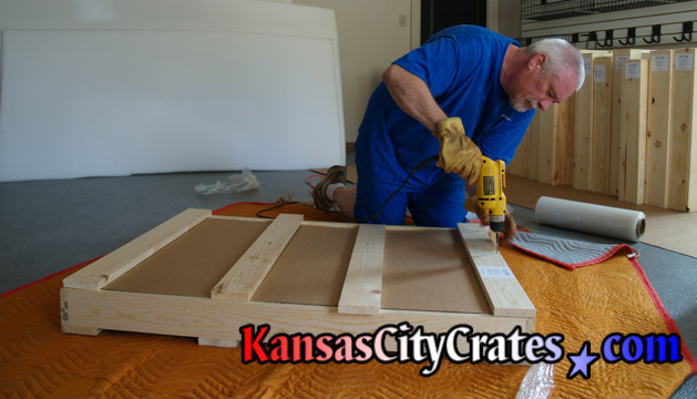 Additional screws are added to crates for stiffness.
