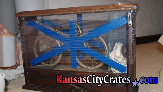 Preparing Wright Cycle Company Van Cleve Bicycle for crating.  circa 1896