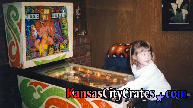 Little girl playing 1967 Wild Life pinball machine by D. Gottlieb and Co.