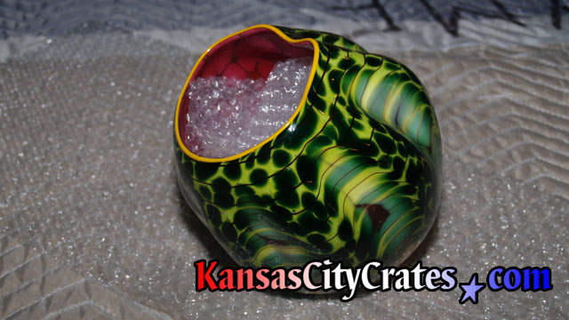 Reptile green pattern on outside and blood red inside.