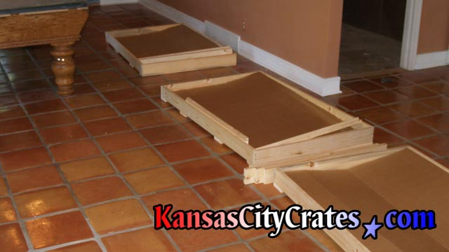 3 crates lined up for loading of slate once removed from billiard table base.