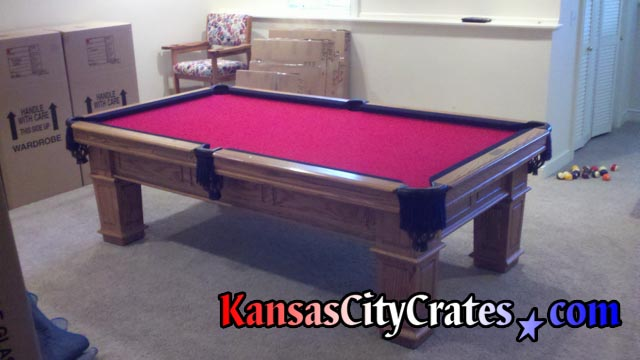 Two tone red and black slate pool table after moving and crating.