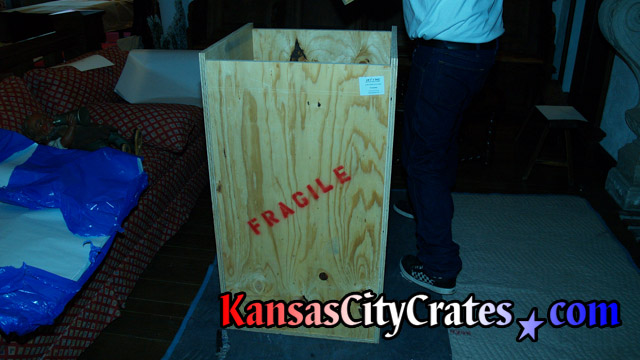 Indextructible box crate on blanket for héraut d'armes bronze statue at mansion in Kansas City MO