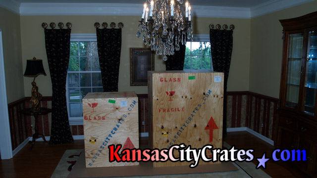 Two chandeliers fully packed and crated staged on cardboard wating for loading at home in Bates City MO  64011