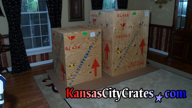 Solid wall vault crates on flooring protection in mansion before shipping.