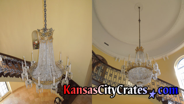 Two views of fine chandelier with crystal bags, drops and original bobeche drip pans before removal for crating.