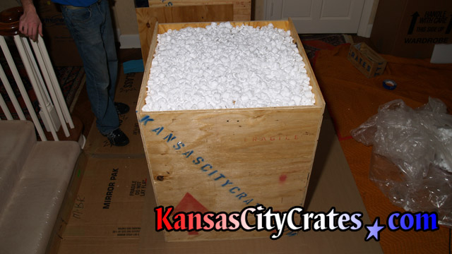 Fully packed chandelier in export crate on flooring protection at Kansas City mansion.