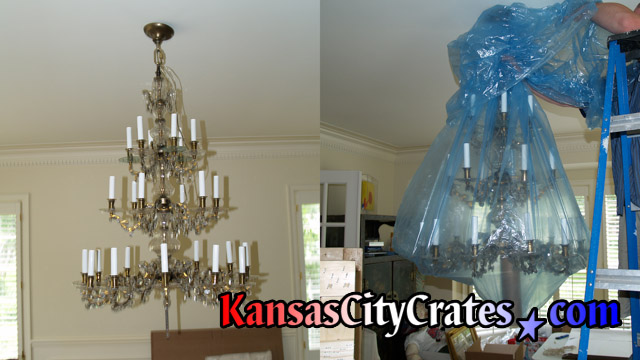 Two views of 30 arm alrge chandelier getting bagged for crating at home in Smithville MO  64089