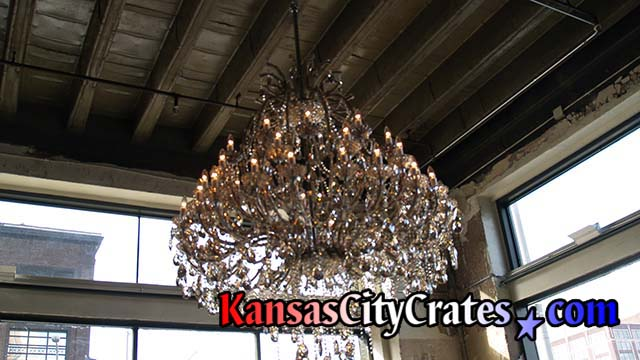Removing large crystal chandelier to ship