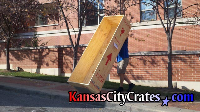 Removing wood box crate from residence after local move at home in Kansas City MO  64112