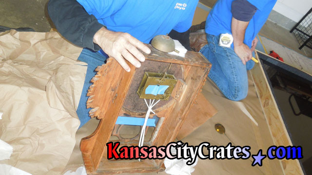 Bonnet panel of antique grandmother clock removed showing service points before packing and crating at home in Loch Lloyd MO 64012