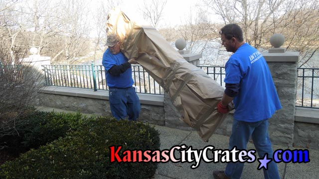 Moving paper wrapped clock longcase outside to crating area at home in Loch Lloyd MO 64012