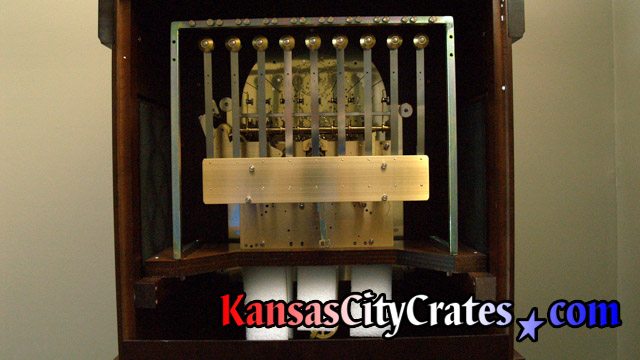 Tubular chimes removed from clock before packing into crate for transport at Kansas City home.