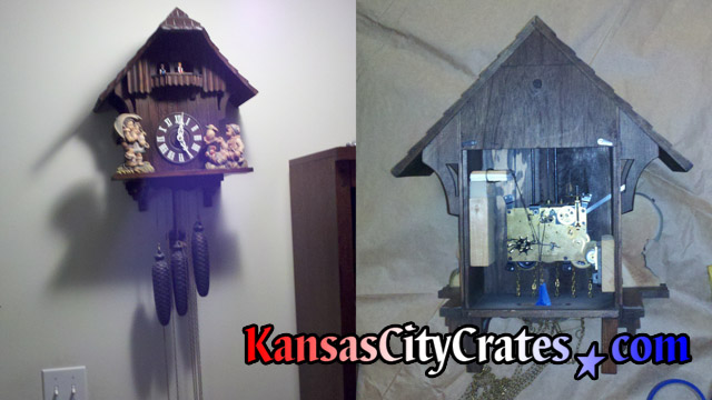 Cuckoo clock removed from wall laying on paper with back removed to access bellows, dancing platform gear and figures for service before packing into export crate at home in Leavenworth KS  66048