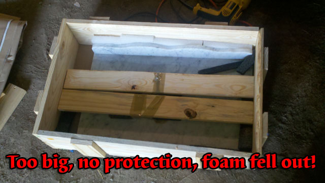 Marble top laying bare in wood crate with no protection.