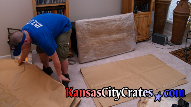 Preparing TV for crating.