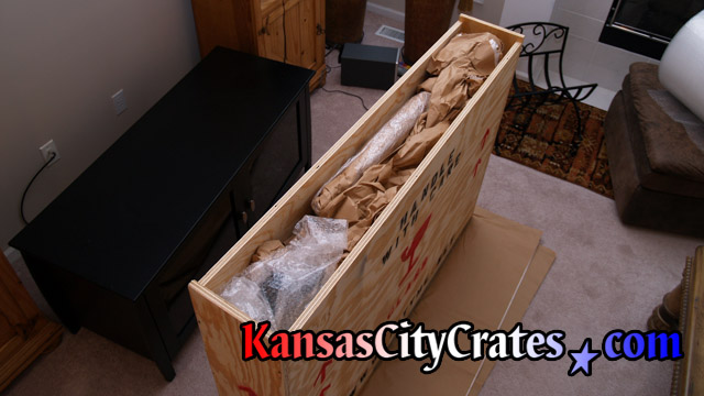 Crate company packing television.