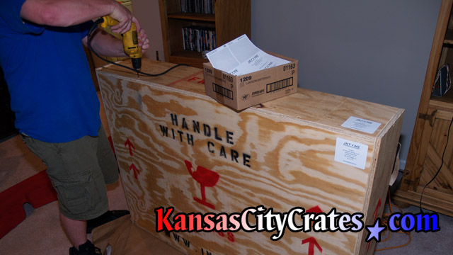 Crates are marked with shipping symbols for handlers.