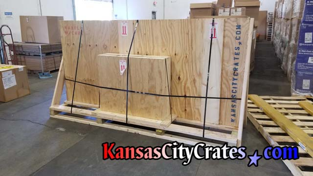 Custom table and legs packed into solid wall crates and steel banded to custom pallet for LTL shipping to Texas