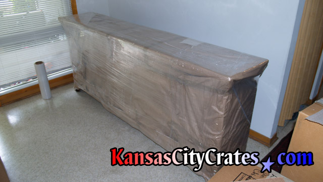 Wrapping of antique wood serving buffet at Fort Leavenworth KS.