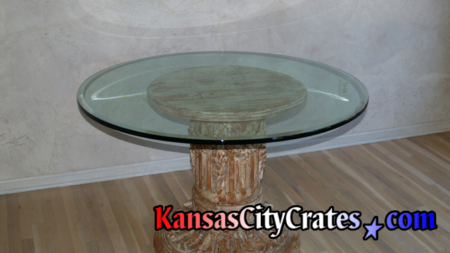 Thick round glass coffee table top before packing and crating.